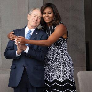 George W. Bush and Michelle Obama hugging